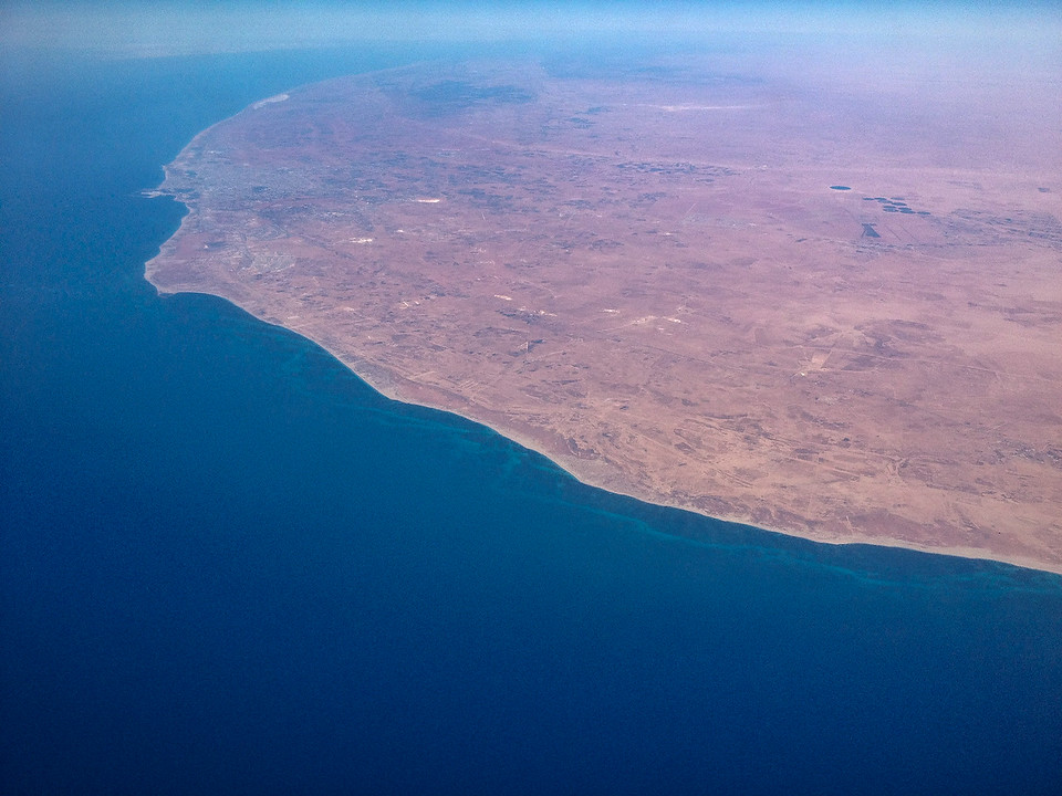 Flying south from Amsterdam to Nairobi, we crossed over the Mediterranean into Africa over Libya. If the tracking map was to be believed, the city near the top of this photo is Benghazi.